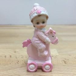 Baby på gunghäst, rosa