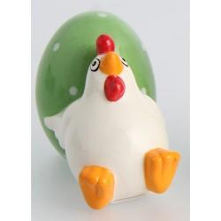 Höna bredvid grönt ägg, dekoration